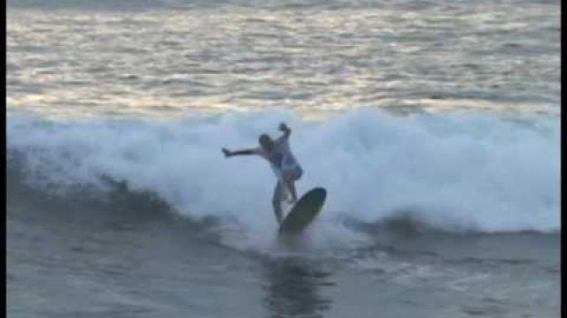Longboarder ollies boogie boarder